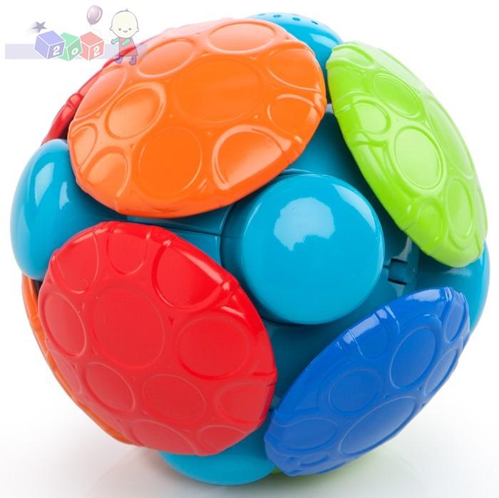 Wirująca piłka Oball - zabawka do raczkowania z dźwiękami i wibracjami 3m+