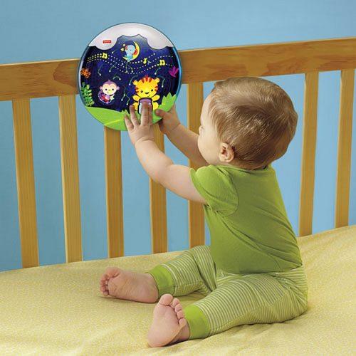 """Fisher Price Uspokajacz """"Spadające Gwiazdki"""" panel do łóżeczka z efektami świetlnymi oraz dźwiękiem."""