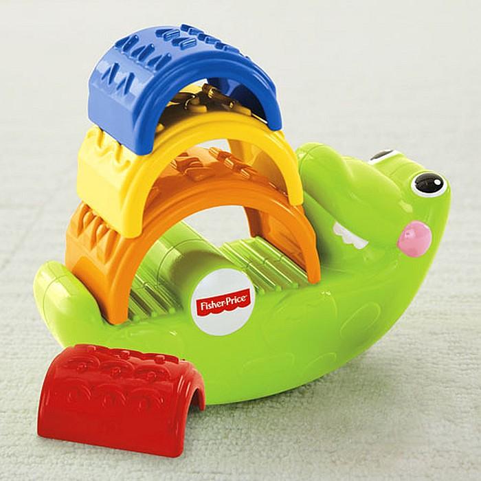Fisher Price Rozkołysany Krokodyl z czterema klockami w kształcie łuków.