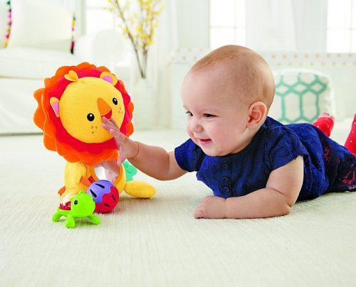 Pluszowy lew z zabawkami Przytulanka Fisher Price