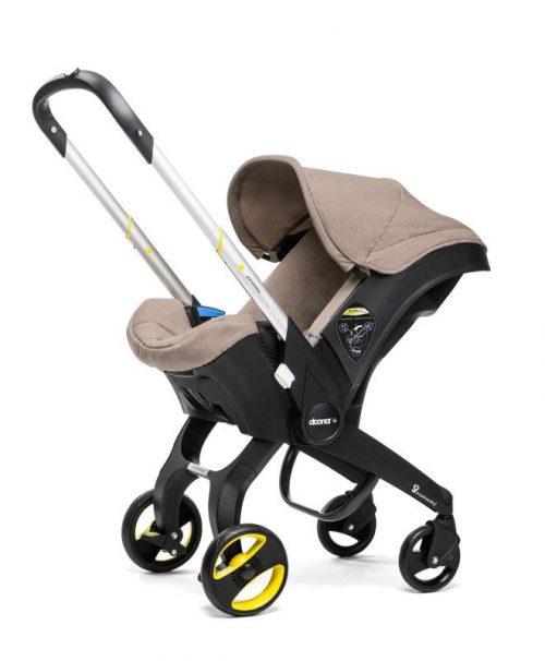 Mobilny fotelik samochodowy  z ramą wózka spacerowego Doona +mata zabezpieczająca fotel gratis