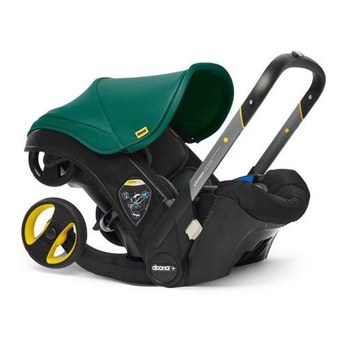 Doona Plus Mobilny fotelik samochodowy z ramą wózka spacerowego Doona Plus kolor Racing Green